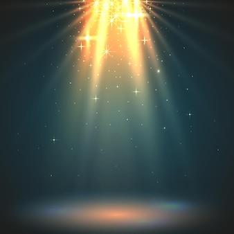 抽象的な魔法の光の背景。ゴールデンホリデーバースト。