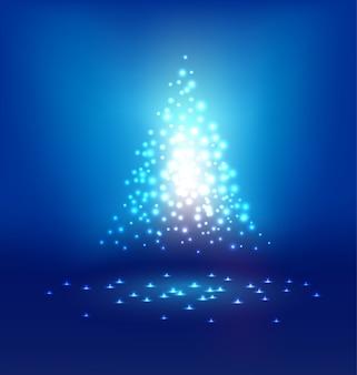 クリスマスの日に青色の背景に抽象的な魔法の光
