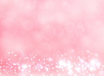 Abstract pink blurred light background with bokeh effect.
