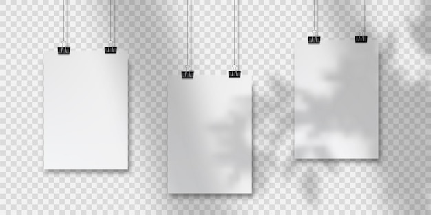 Abstract poster design with hanging papers. hanging a4paper poster mockup. three  sheets of paper hangs against a wall background with overlay shadows from the window and vegetation outside the window