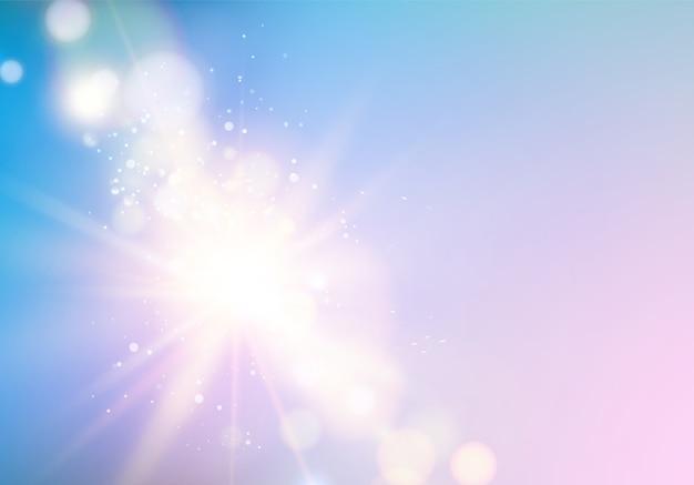 青い空の上のボケ味を持つ抽象的な光線