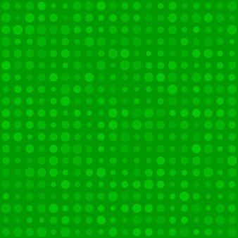 緑色のさまざまなサイズの小さな円またはピクセルの抽象的なシームレスパターン