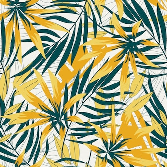 Abstract seamless pattern with bright tropical leaves and plants
