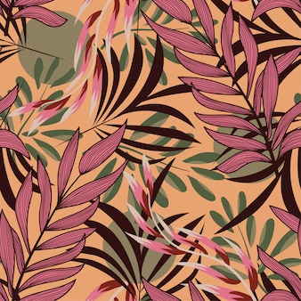 Abstract seamless pattern with colorful tropical leaves and bright plants on yellow