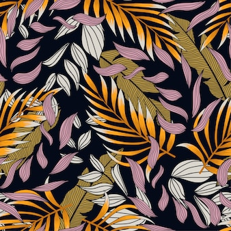 Abstract seamless pattern with colorful tropical leaves and flowers on purple background