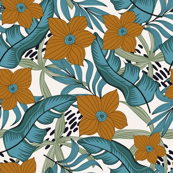 Abstract seamless pattern with colorful tropical leaves and flowers on white background