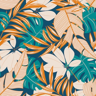 Abstract seamless pattern with colorful tropical leaves and flowers