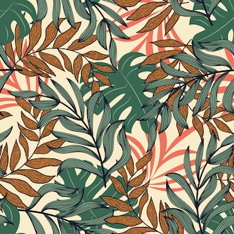 Abstract seamless pattern with colorful tropical leaves and plants on beige background