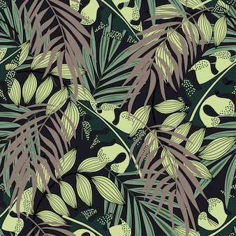 Abstract seamless pattern with colorful tropical leaves and plants on brown background
