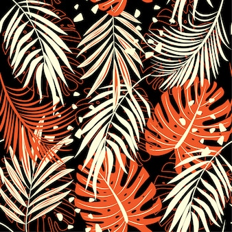 Abstract seamless pattern with colorful tropical leaves and plants on dark