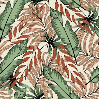 Abstract seamless pattern with colorful tropical leaves and plants on a delicate background