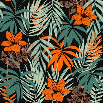 Abstract seamless pattern with colorful tropical leaves and plants on green
