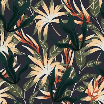 Abstract seamless pattern with colorful tropical leaves and plants on grey background