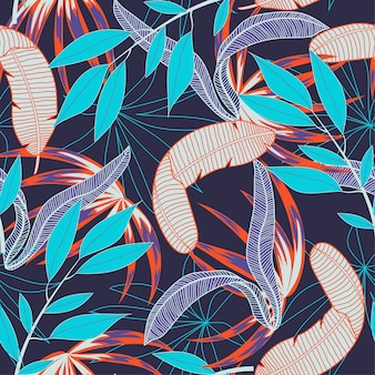 Abstract seamless pattern with colorful tropical leaves and plants on purple