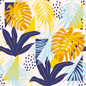 Abstract seamless pattern with colorful tropical leaves and plants