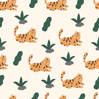 熱帯の葉と虎との抽象的なシームレスパターン。