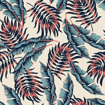 明るい植物とベージュの葉と抽象的なシームレスな熱帯パターン