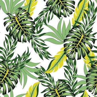明るい植物と葉を持つ抽象的なシームレスな熱帯パターン