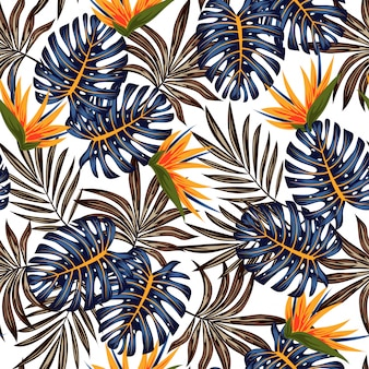 Abstract seamless tropical pattern with bright plants and leaves on a delicate