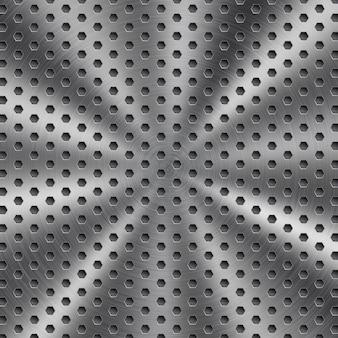 円形の起毛テクスチャと六角形の穴と銀色の抽象的な光沢のある金属の背景