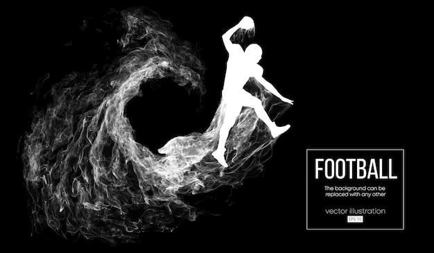 粒子、ほこり、煙、蒸気から暗い黒の背景にアメリカンフットボール選手の抽象的なシルエット。ボールとジャンプのフットボール選手。ラグビー。