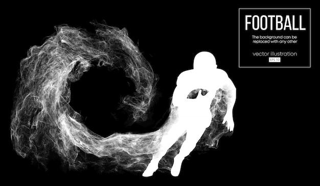 粒子、ほこり、煙、蒸気から暗い黒の背景にアメリカンフットボール選手の抽象的なシルエット。ボールを持って走るフットボール選手。ラグビー。