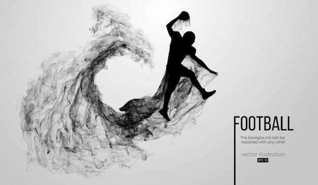 粒子、ほこり、煙、蒸気から白い背景の上のアメリカンフットボール選手の抽象的なシルエット。ボールとジャンプのフットボール選手。ラグビー。