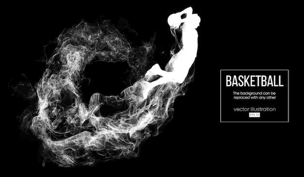 입자, 먼지, 연기, 증기에서 어두운 검정색 배경에 농구 선수의 추상 실루엣. 농구 선수가 점프하고 슬램 덩크를 수행합니다.