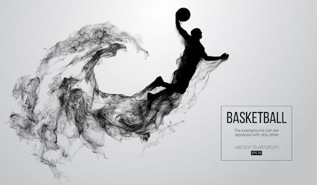 입자, 먼지, 연기, 증기에서 흰색 배경에 농구 선수의 추상 실루엣. 농구 선수가 점프하고 슬램 덩크를 수행합니다.