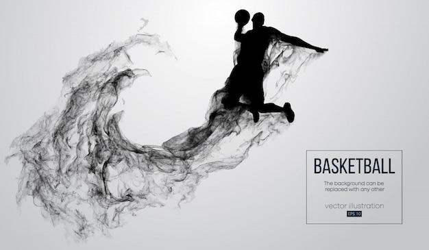 粒子、ほこり、煙、蒸気から白い背景の上のバスケットボール選手の抽象的なシルエット。ジャンプしてスラムダンクを行うバスケットボール選手。