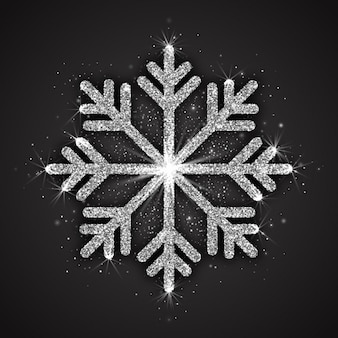 Abstract silver sparkling snowflake with shimmer glitter texture isolated on dark gray background