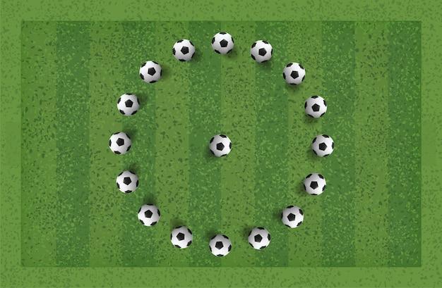 Abstract soccer football ball in green grass field.