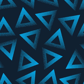 Abstract stippled blue triangles seamless pattern