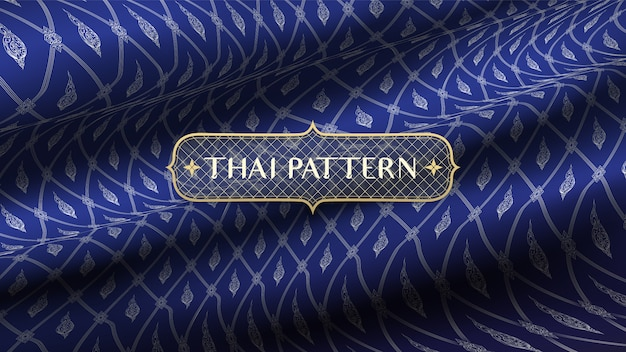 Abstract traditional thai decoration, on realistic rip curl blue silk fabric background.