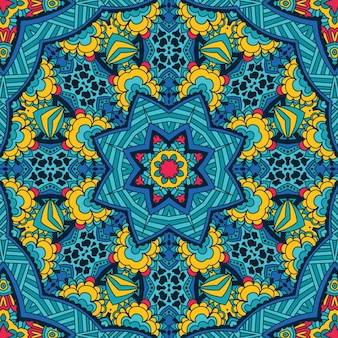 装飾的な抽象的な部族のお祝いの民族のシームレスなパターン