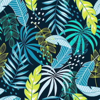 Abstract tropical seamless pattern with blue and green flowers and plants