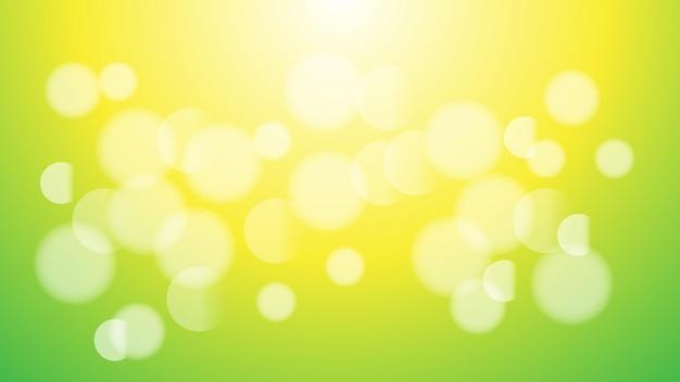 装飾的なデザインの緑と黄色のグラデーションカラーの背景に抽象的な白いぼやけたボケ