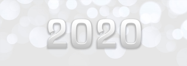 Abstract white bokeh new year 2020 banner