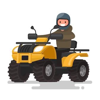 アクティブな休日。四輪バイク。ヘルメットの男は黄色のatvに乗っています。図