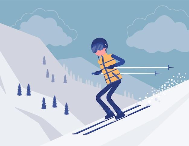 下り坂でスキーをするアクティブなスポーティな男
