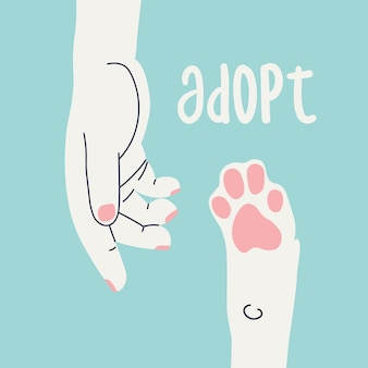 Adopt human hand reaches for a dogs pawcalling for adoption of animals from the shelter