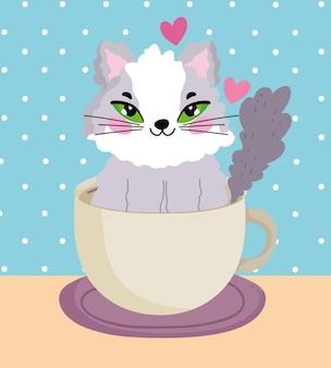 コーヒーカップ漫画ベクトルイラストの中の愛らしい猫