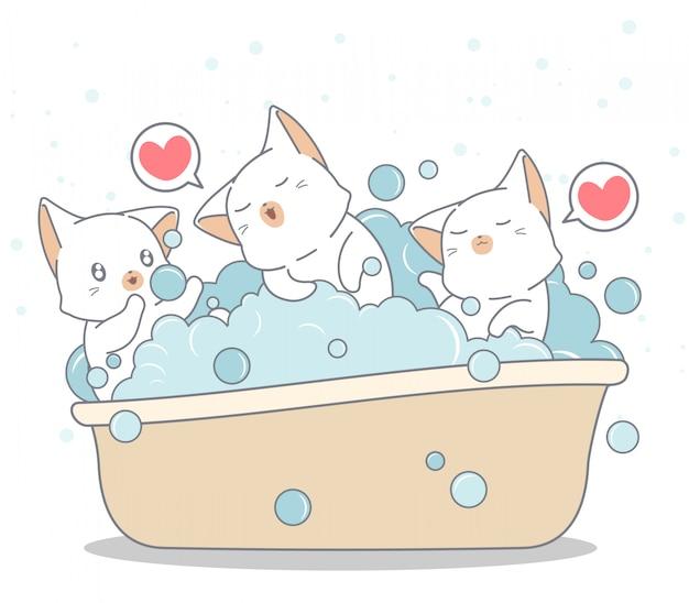 Adorable cats are bathing in the bathtub