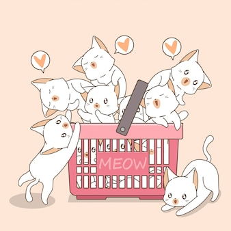 Adorable cats in the pink basket