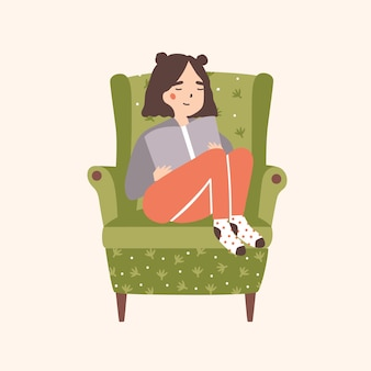 Adorable girl sitting in comfy armchair and reading book isolated Premium Vector