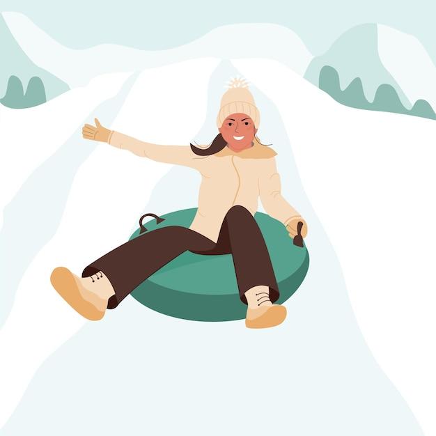 愛らしいうれしそうな女の子がスノーチュービングの雪崩から降りる冬の屋外の子供たちの活動