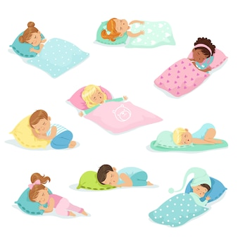 Adorable little boys and girls sleeping sweetly in their beds