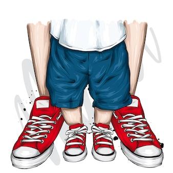 スタイリッシュなスニーカーの子供と親の大人と子供の足