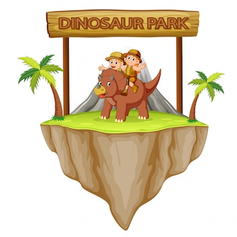 The adventurer are playing with the triceratops in the dinosaur park