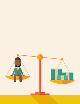 Afircan businessman on a balance scale